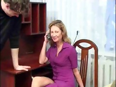mature woman sucks and fucks two young guys